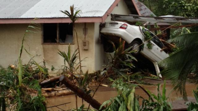 Cyclone Evan car and house
