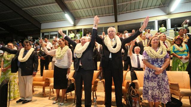 Elder Hamula and President Flosse Waving