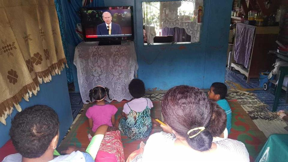 A family in Fiji watching General Conference.