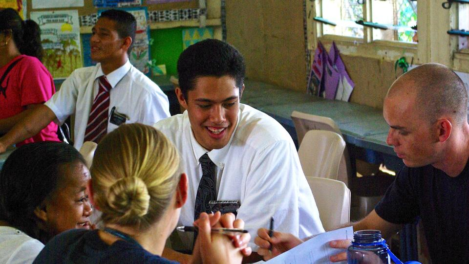 Elder Feagai serves as interpreter for special needs children