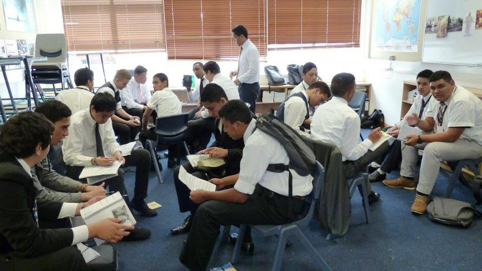 Young men study in preparation for the morning devotional.